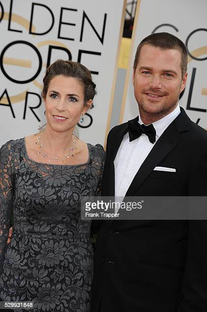 Actor Chris O'Donnell and guest Caroline Fentress arrive at the 71st Annual Golden Globe Awards held at The Beverly Hilton Hotel