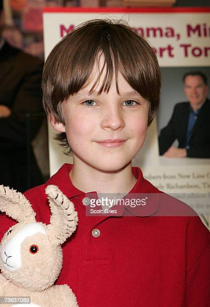 Actor Chris O'Neil poses with the limited edition Mimzy doll during a doll signing to celebrate the premiere of The Last Mimzy at FAO Schwarz March...