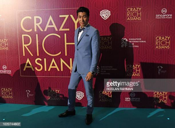 Actor Chris Pang poses at the film premiere of 'Crazy Rich Asians' at the Capitol Theatre in Singapore on August 21 2018