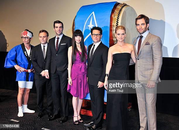 Actor Chris Pine actress Alice Eve director JJ Abrams actress Chiaki Kuriyama actor Zachary Quinto and producer Bryan Burk attend the 'Star Trek Into...