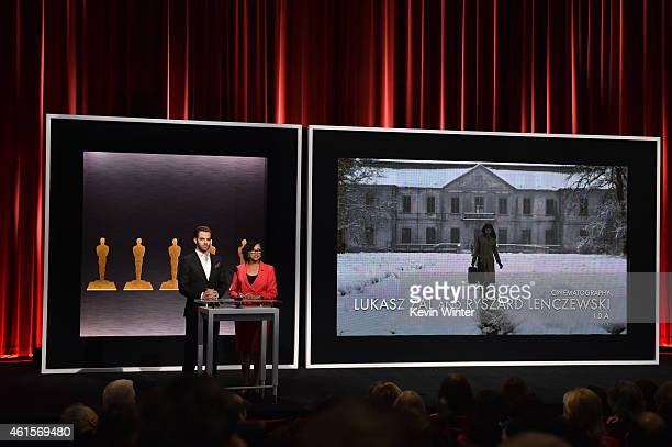 Actor Chris Pine and Academy President Cheryl Boone Isaacs announce Lukasz Zal and Ryszard Lenczewski as nominees for Best Cinematography in the film...