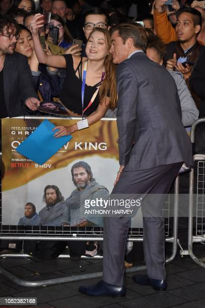 US actor Chris Pine poses for a selfie upon arrival for the European premiere of the film 'Outlaw King' during the BFI London Film Festival in London...