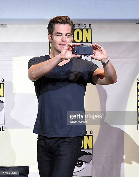 Actor Chris Pine takes a photo at the Warner Bros Presentation during ComicCon International 2016 at San Diego Convention Center on July 23 2016 in...