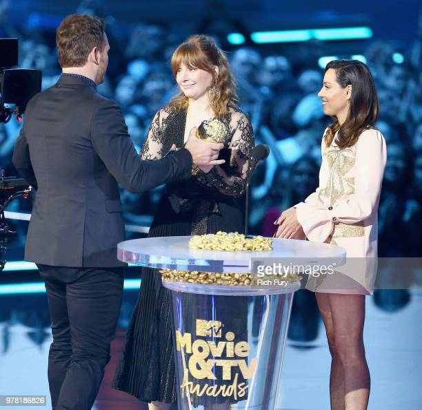 Actor Chris Pratt accepts the MTV Generation Award from actors Bryce Dallas Howard and Aubrey Plaza during the 2018 MTV Movie And TV Awards at Barker...