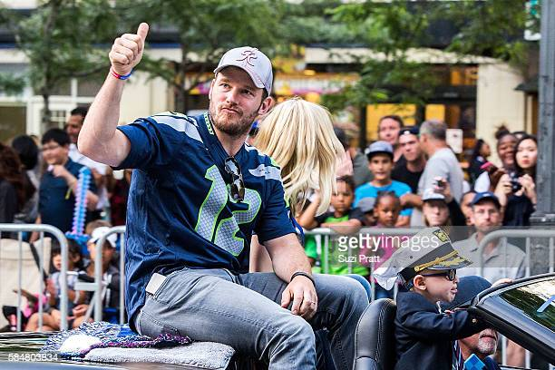 Actor Chris Pratt and son Jack Pratt ride in the Seafair Torchlight Parade Grand Marshal vehicle on July 30, 2016 in Seattle, Washington.