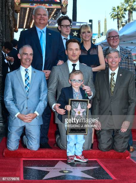 Actor Chris Pratt holds his son while posing at his Hollywood Walk of Fame Star ceremony on April 21 2017 in Hollywood California where Pratt was the...