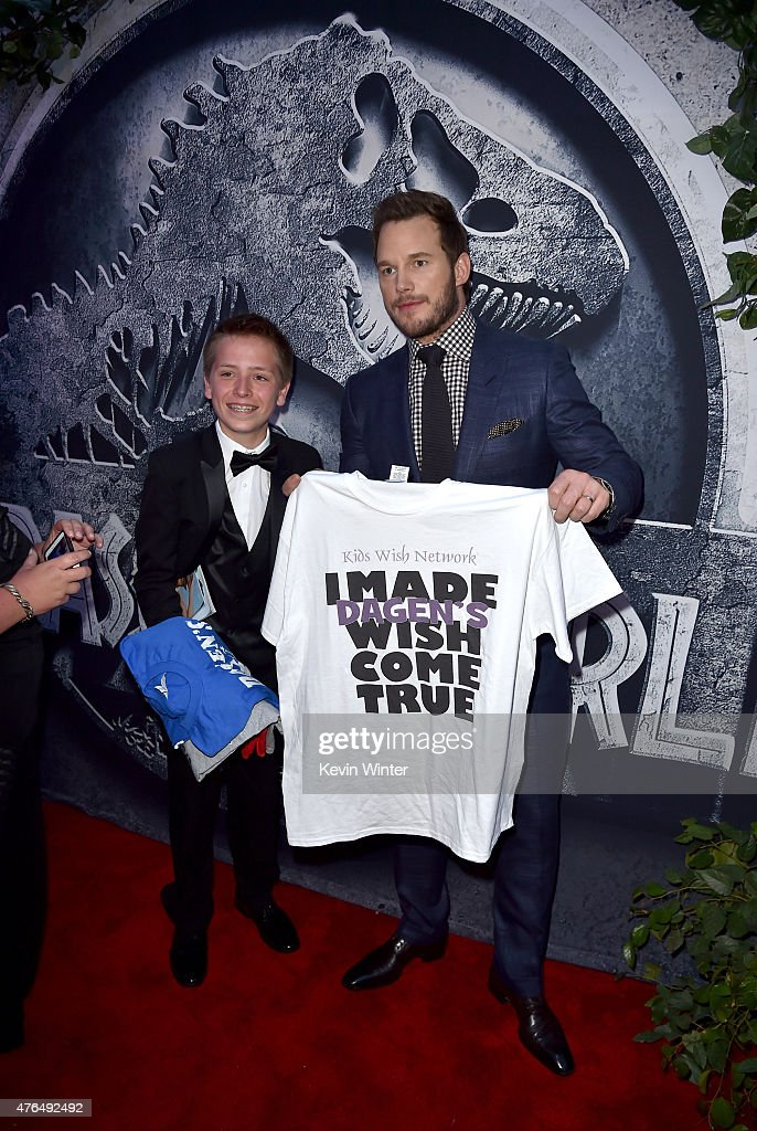 Actor Chris Pratt (R) poses with Dagen from Kids Wish Network as they attend the Universal Pictures' 'Jurassic World' premiere at the Dolby Theatre on June 9, 2015 in Hollywood, California.