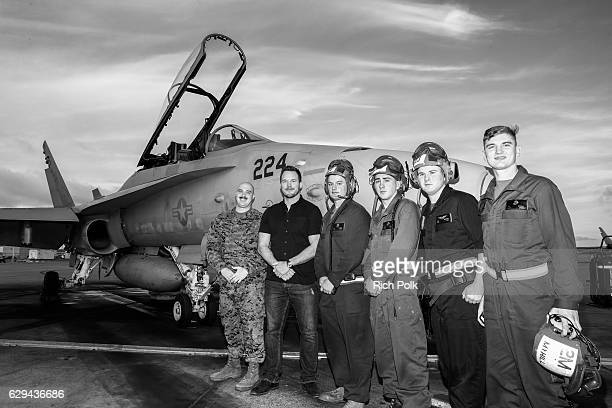 Actor Chris Pratt poses with US Marines at Marine Corps Air Station Miramar on December 12 2016 in San Diego California