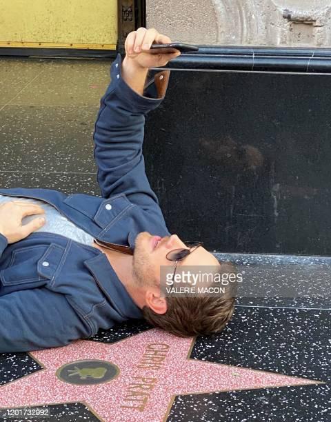 US actor Chris Pratt takes a selfie on his Walk of Fame star before attending Disney Pixar's Onward premiere at El Capitan theatre in Hollywood on...