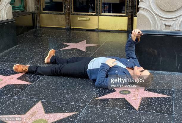 "Actor Chris Pratt takes a selfie on his Walk of Fame star before attending Disney Pixar's ""Onward"" premiere at El Capitan theatre in Hollywood on..."