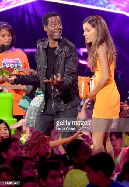 Actor Chris Rock and actress Ariana Grande speak onstage during Nickelodeon's 27th Annual Kids' Choice Awards held at USC Galen Center on March 29...