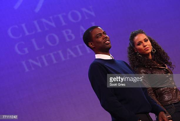 Actor Chris Rock and musician Alicia Keys appear on stage during 'Giving Live At The Apollo' presented by the MTV and Clinton Global Initiative at...
