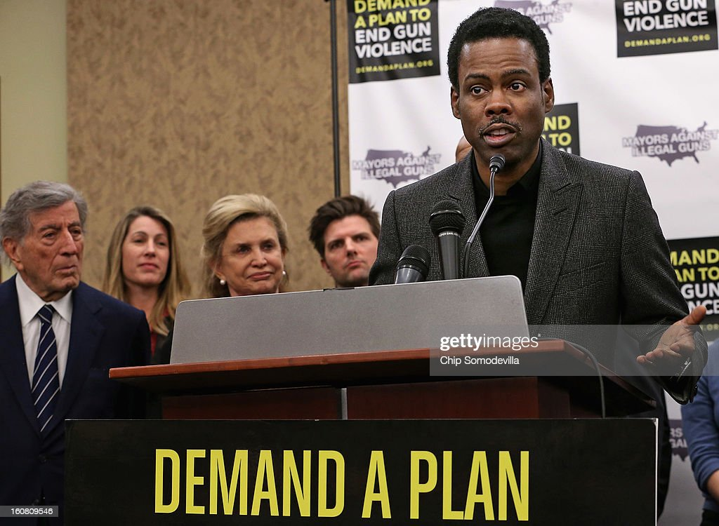 Actor Chris Rock (R) speaks during a press conference hosted by the Mayors Against Illegal Guns and the Law Center to Prevent Gun Violence with (L-R) singer Tony Bennett, LCPGV Executive Director Robyn Thomas, Rep. Carolyn Maloney (D-NY) and actor Adam Scott at the U.S. Capitol February 6, 2013 in Washington, DC. The artists, activists and politicians called for manditory background check on all gun purchases among other restrictions.