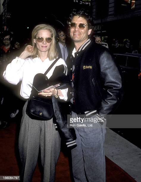 Actor Chris Sarandon and wife Lisa Ann Cooper attend the 'Top Gun' New York City Premiere on May 12 1986 at Loews Theater in New York City New York