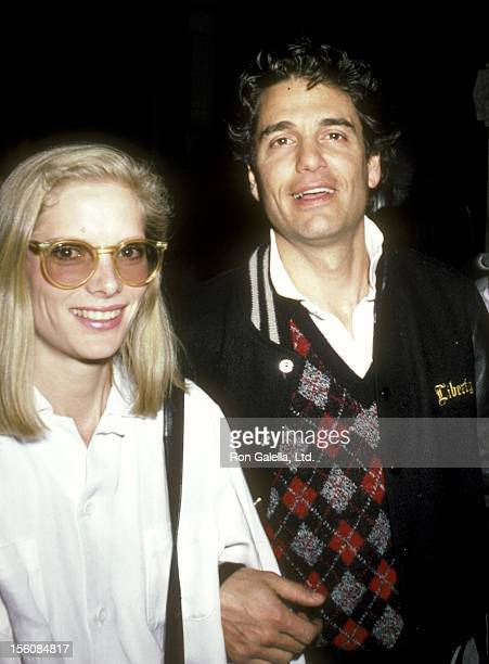 Actor Chris Sarandon and wife Lisa Ann Cooper attend the 'Top Gun' New York City Premiere Party on May 12 1986 at America in New York City New York