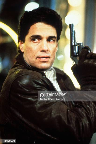 Actor Chris Sarandon with gun in a scene from the film 'Child's Play' 1988