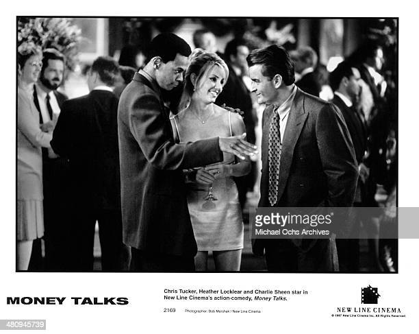 Actor Chris Tucker actress Heather Locklear and actor Charlie Sheen in a scene from the movie Money Talks circa 1997