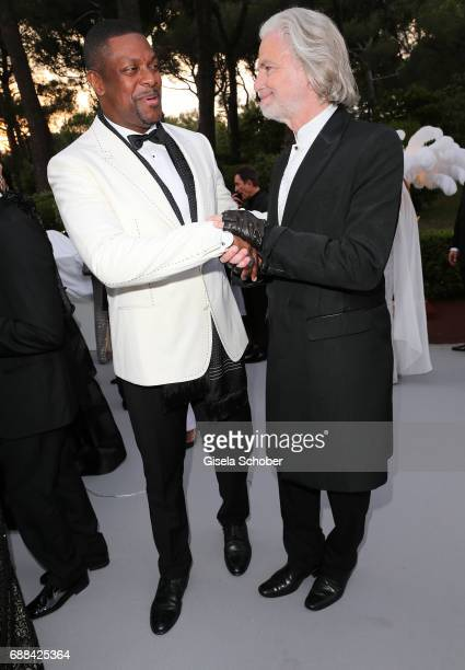 Actor Chris Tucker and Hermann Buehlbecker arrive at the amfAR Gala Cannes 2017 at Hotel du CapEdenRoc on May 25 2017 in Cap d'Antibes France