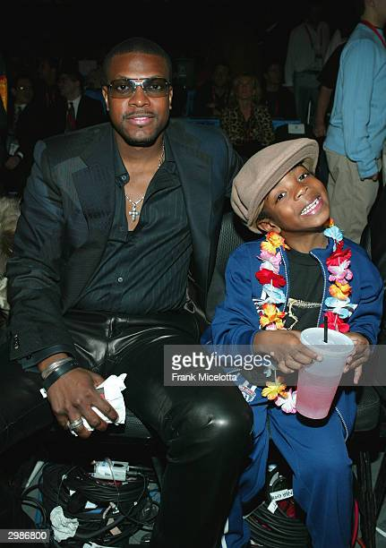 Actor Chris Tucker and his 5 year old son Justin attend the 2004 NBA AllStar Game held at the Staples Center February 15 2004 in Los Angeles...