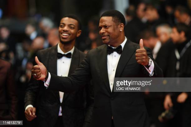 US actor Chris Tucker and his son Destin Christopher Tucker arrive for the screening of Homage to Sylvester Stallone Rambo First Blood at the 72nd...