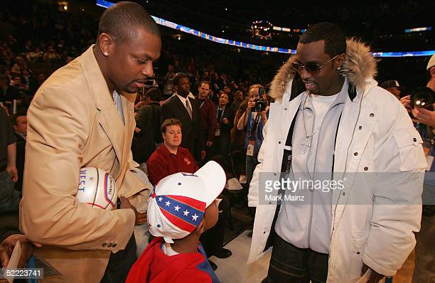 Actor Chris Tucker and his son talk with Sean 'P Diddy' Combs at the 2005 NBA All Star Game at the Pepsi Center on February 20 2005 in Denver Colorado