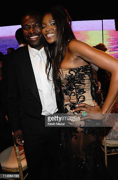 Actor Chris Tucker and model Naomi Campbell who wore a High Jewellery diamond necklace in her hair during the 10th Annual White Tie and Tiara Ball to...