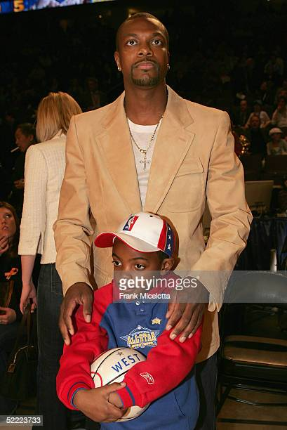 Actor Chris Tucker and son attend the 2005 NBA All Star Game at the Pepsi Center on February 20 2005 in Denver Colorado