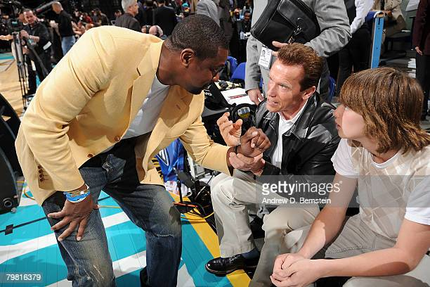 Actor Chris Tucker talks with Governor Arnold Schwarzenegger of California and his son Patrick prior to the start of the 2008 NBA AllStar Game part...