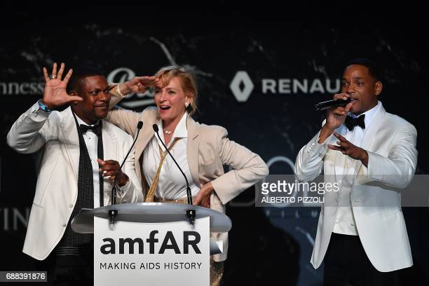 US actor Chris Tucker US actress Uma Thurman and US actor Will Smith conduct an auction during the amfAR's 24th Cinema Against AIDS Gala on May 25...
