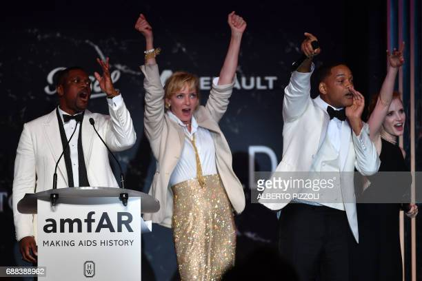 US actor Chris Tucker US actress Uma Thurman US actor Will Smith and US actress Jessica Chastain conduct an auction during the amfAR's 24th Cinema...