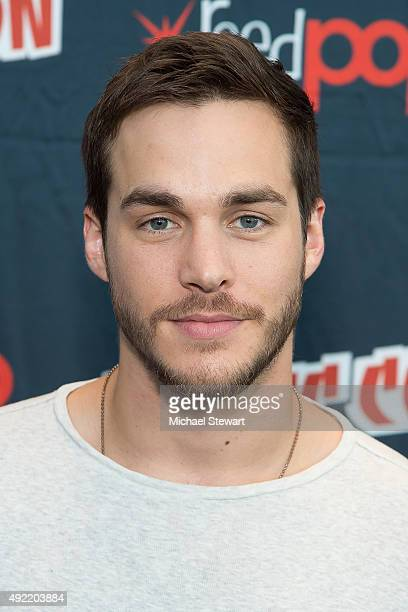 Actor Chris Wood poses in the press room for the 'Containment' panel during New York ComicCon Day 3 at The Jacob K Javits Convention Center on...