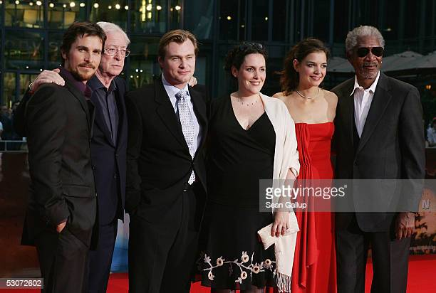 Actor Christian Bale actor Michael Caine director Christopher Nolan producer Emma Thomas actress Katie Holmes and actor Morgan Freeman arrive for the...