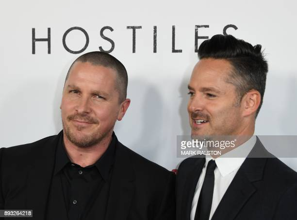 Actor Christian Bale and director Scott Cooper arrive at the premiere of 'Hostiles' in Beverly Hills California on December 14 2017 / AFP PHOTO /...