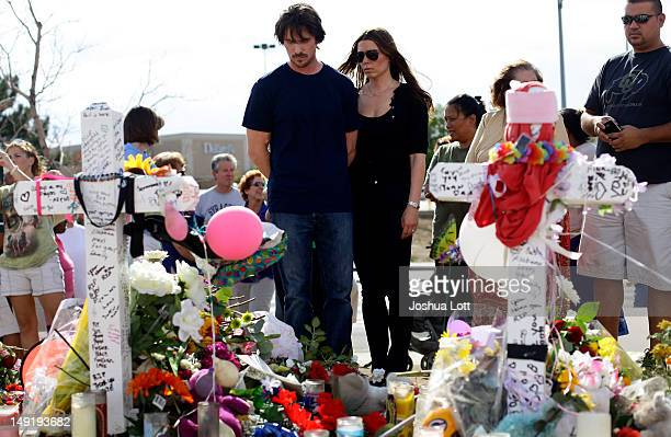 Actor Christian Bale and his wife Sandra Blazic visit the memorial across the street from the Century 16 movie theater July 24 2012 in Aurora...