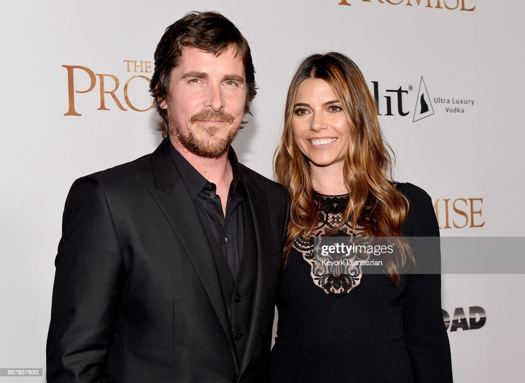 Actor Christian Bale (L) and Sibi Blazic attend the premiere of Open Road Films' 'The Promise' at TCL Chinese Theatre on April 12, 2017 in Hollywood, California.