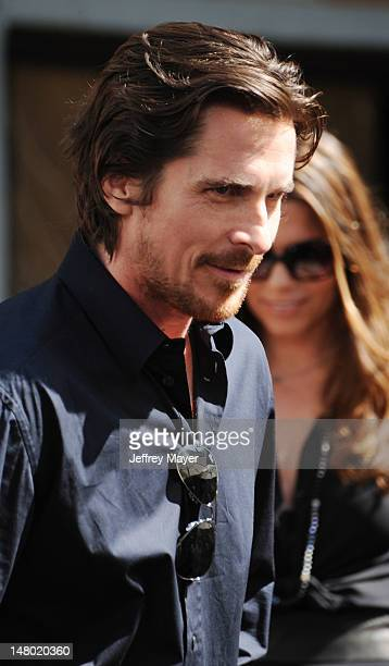 Actor Christian Bale attends Christopher Nolan hand and footprint ceremony at Grauman's Chinese Theatre on July 7 2012 in Hollywood California