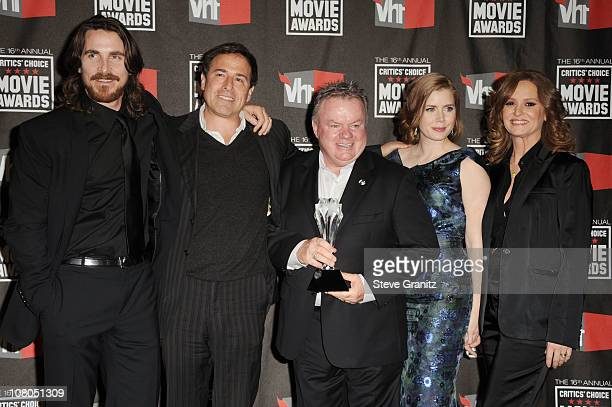Actor Christian Bale director David O Russell actor Jack McKee actress Amy Adams and actress Melissa Leo pose in the press room at the 16th Annual...