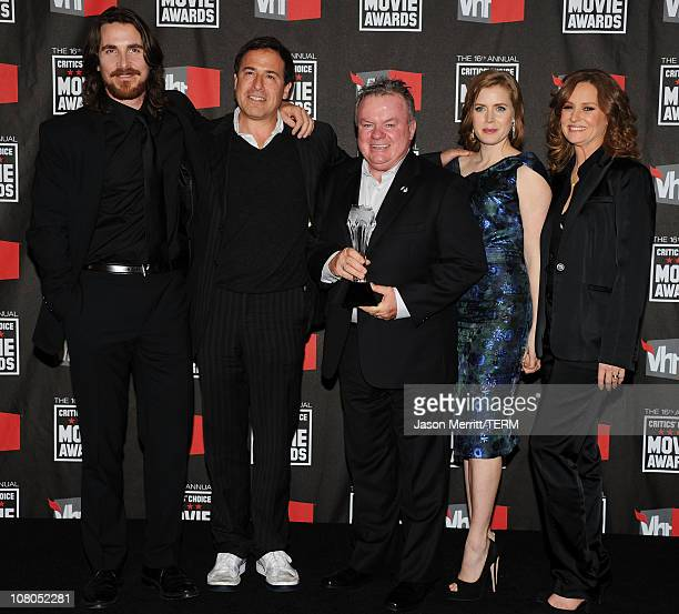 Actor Christian Bale director David O Russell actor Jack MKee actress Amy Adams and Melissa Leo pose in the press room during the 16th annual...
