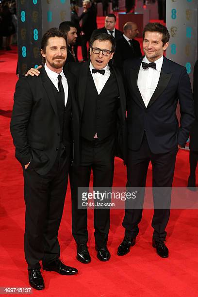 Actor Christian Bale director David O Russell and actor Bradley Cooper attend the EE British Academy Film Awards 2014 at The Royal Opera House on...