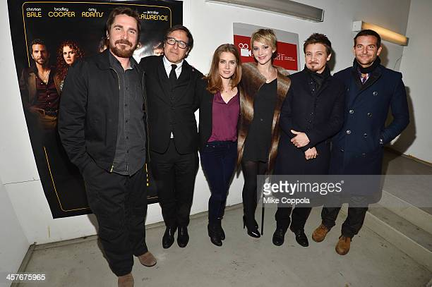 Actor Christian Bale Film Director David O Russell Actors Amy Adams Jennifer Lawrence Jeremy Renner and Bradley Cooper pose for a picture at AMC...