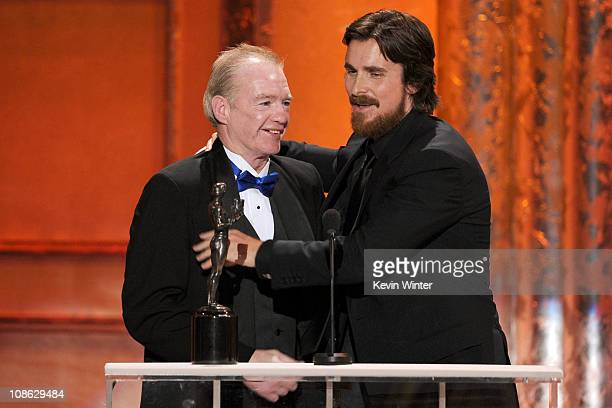 Actor Christian Bale , winner of Outstanding Performance by a Male Actor in a Supporting Role award for 'The Fighter,' and former boxer Dicky Eklund...
