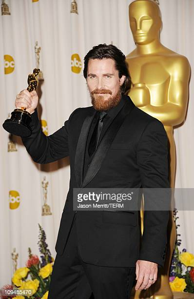 Actor Christian Bale, winner of the award for Best Actor in a Supporting Role for 'The Fighter', poses in the press room during the 83rd Annual...