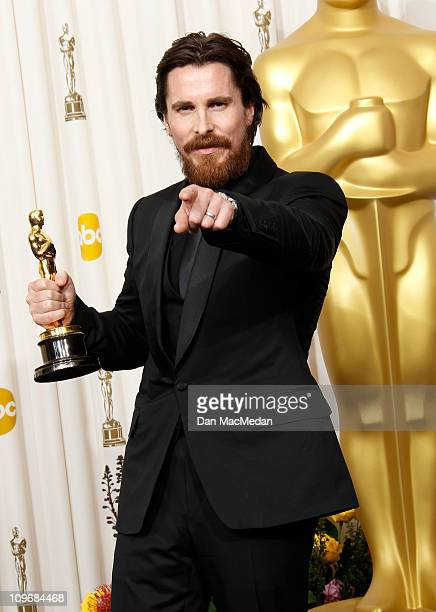 Actor Christian Bale winner of the award for Best Actor in a Supporting Role for 'The Fighter' poses in the press room at the 83rd Annual Academy...