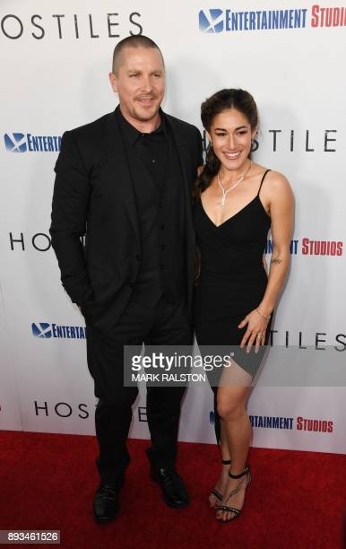 Actor Christian Bale with Q'orianka Kilcher at the premiere of 'Hostiles' in Beverly Hills California on December 14 2017 / AFP PHOTO / MARK RALSTON