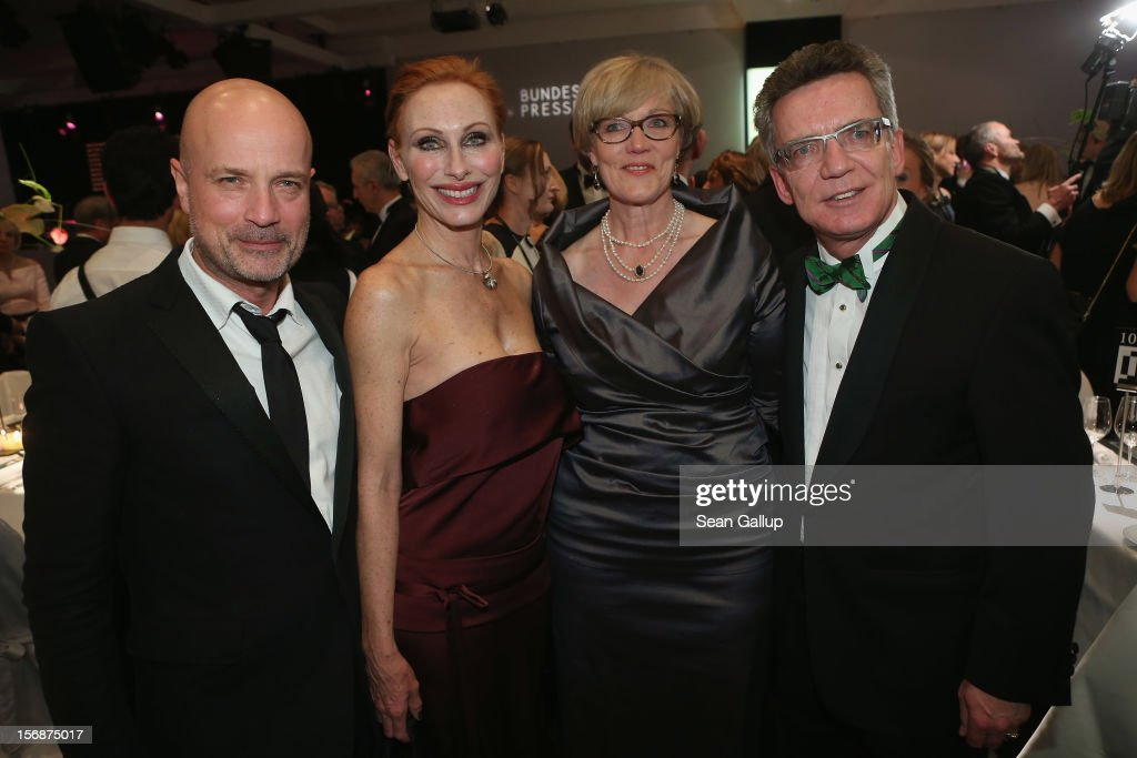 Actor Christian Berkel, actress Andrea Sawatzki, Martina de Maiziere and German Defense Minister Thomas de Maiziere attend the 2012 Bundespresseball (Federal Press Ball) at the Intercontinental Hotel on November 23, 2012 in Berlin, Germany.