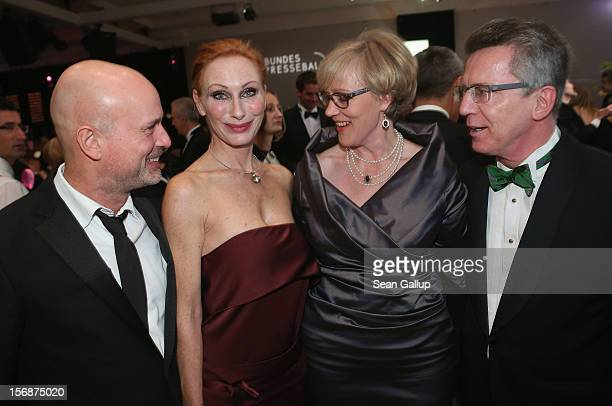 Actor Christian Berkel actress Andrea Sawatzki Martina de Maiziere and German Defense Minister Thomas de Maiziere attend the 2012 Bundespresseball at...