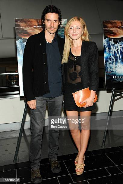 Actor Christian Camargo and actress Juliet Rylance attend Europa Report New York Premiere at American Museum of Natural History on August 1 2013 in...