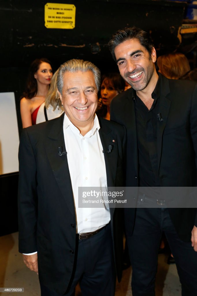 Actor Christian Clavier and humorist and actor Ary Abittan pose backstage prior to the recording of television show host's Michel Drucker's 'Vivement Dimanche' weekly show, whose guest of honor is Clavier, at Pavillon Gabriel on March 26, 2014 in Paris, France.