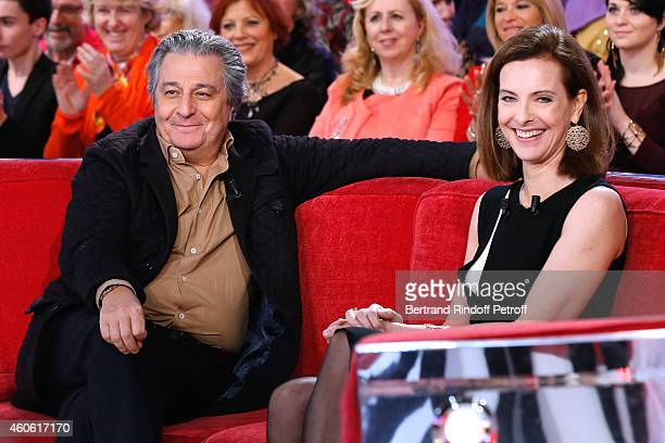 Actor Christian Clavier and main guest of the show actress Carole Bouquet present the movie Une heure de tranquilite during the 'Vivement Dimanche'...