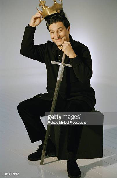 Actor Christian Clavier holds a crown and a sword used in his 1998 French film Couloirs du Temps Les Visiteurs 2 The film directed by JeanMarie Poire...